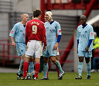 Photo: Jed Wee.<br />Nottingham Forest v Chesterfield. Coca Cola League 1.<br />31/12/2005.<br />Tempers flare as Chesterfield's Steve Blatherwick confronts Forest's Gareth Taylor.