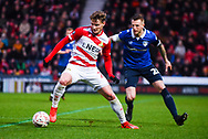 Kieran Sadlier of Doncaster Rovers (22) holds up the ball away from Peter Clarke of Oldham Athletic (26) during the The FA Cup fourth round match between Doncaster Rovers and Oldham Athletic at the Keepmoat Stadium, Doncaster, England on 26 January 2019.