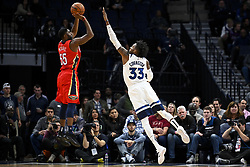 November 14, 2018 - Minneapolis, MN, USA - The Minnesota Timberwolves' Robert Covington (33) guards against a shot by the New Orleans Pelicans' E'Twaun Moore (55) in the first half on Wednesday, Nov. 14, 2018, at Target Center in Minneapolis. (Credit Image: © Aaron Lavinsky/Minneapolis Star Tribune/TNS via ZUMA Wire)