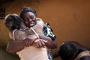 Women embrace in grief after an attack in Kibusu village at Tana Delta region of the Kenyan Coast.