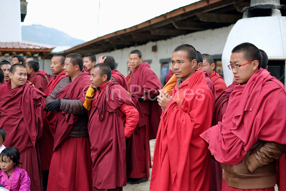 Monks in the audience at the Black-necked Crane festival at Gangte Goemba, Phobjikha Valley, Bhutan. Every year on November 11th, the local community hosts the Black-necked Crane festival at Gangte Goemba, to highlight its significance to the valley. Phobjikha Valley is the most significant overwintering ground of the rare and endangered Black-necked Crane in Bhutan.