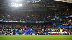 Chelsea and West Ham United players hold a minute applause for the late Ray Wilkins during the Premier League match at Stamford Bridge, London.