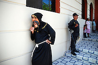 """MEXICO, Veracruz, Tantoyuca, Oct 27- Nov 4, 2009.  125. A dancer, a policeman and a mother and child in Tantoyuca's """"Plaza Constitucion."""" """"Xantolo,"""" the Nahuatl word for """"Santos,"""" or holy, marks a week-long period during which the whole Huasteca region of northern Veracruz state prepares for """"Dia de los Muertos,"""" the Day of the Dead. For children on the nights of October 31st and adults on November 1st, there is costumed dancing in the streets, and a carnival atmosphere, while Mexican families also honor the yearly return of the souls of their relatives at home and in the graveyards, with flower-bedecked altars and the foods their loved ones preferred in life. Photographs for HOY by Jay Dunn."""