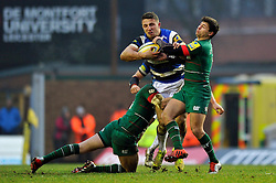Sam Burgess of Bath Rugby is tackled by Owen Williams and Ben Youngs of Leicester Tigers - Photo mandatory by-line: Patrick Khachfe/JMP - Mobile: 07966 386802 04/01/2015 - SPORT - RUGBY UNION - Leicester - Welford Road - Leicester Tigers v Bath Rugby - Aviva Premiership