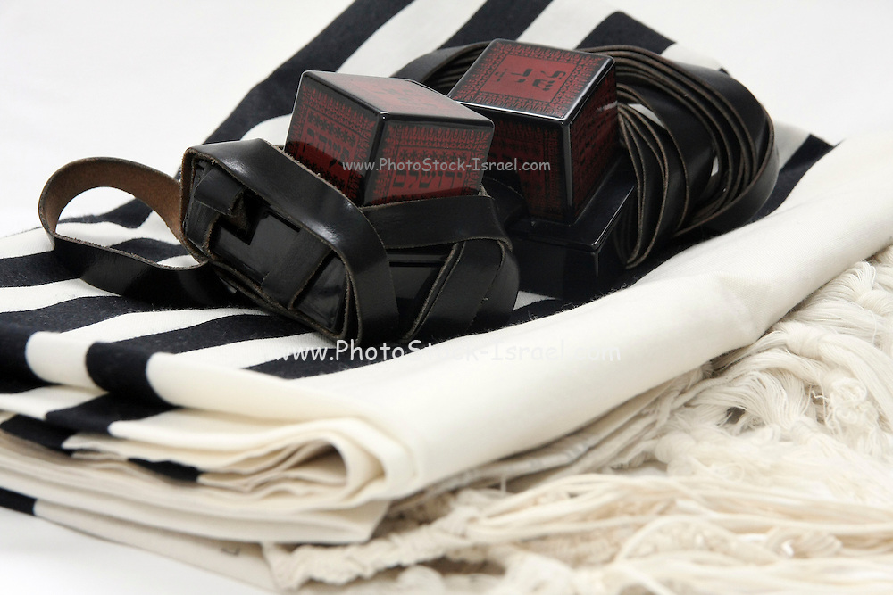 Cutout of Tifillin and Talit on white background