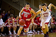 Grinnell forward Aaron Levin '14 sprints alongside Monmouth's Curtis Oler '13 during the second half of the Pioneers' 133-92 rout of the Scots in Darby Gynamsium on Wednesday night.