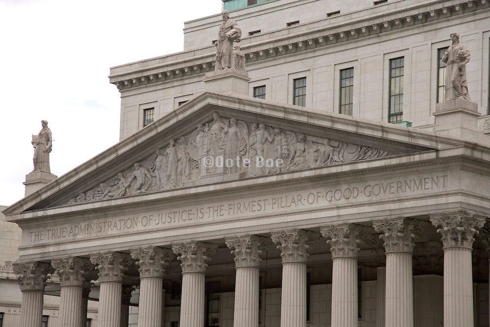 the frieze above the entrance to court house in New York City