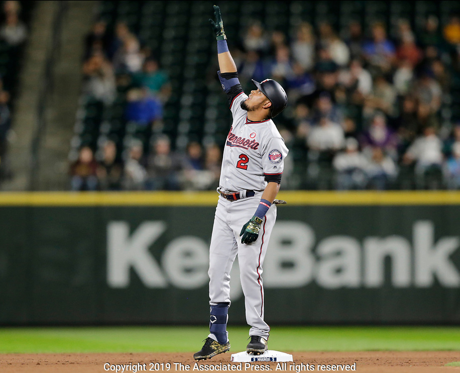 Minnesota Twins' Luis Arraez stands on second base as he celebrates his first MLB hit for a double against the Seattle Mariners during the eighth inning of a baseball game, Saturday, May 18, 2019, in Seattle. (AP Photo/John Froschauer)