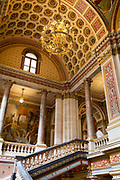 The architecture of the Grand Staircase in the Foreign and Commonwealth Office FCO, on 17th September 2017, in Whitehall, London, England. The main Foreign Office building is in King Charles Street, and was built by George Gilbert Scott in partnership with Matthew Digby Wyatt and completed in 1868 as part of the new block of government offices which included the India Office and later 1875 the Colonial and Home Offices. George Gilbert Scott was responsible for the overall classical design of these offices but he had an amicable partnership with Wyatt, the India Office's Surveyor, who designed and built the interior of the India Office.