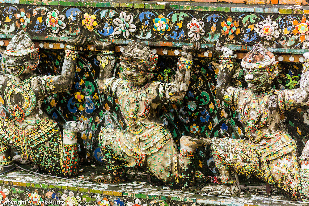 "23 SEPTEMBER 2013 - BANGKOK, THAILAND: Figures of Hanuman, the Monkey God at Wat Arun. The figures are scheduled to be a part of the renovation of the temple. The full name of the temple is Wat Arunratchawararam Ratchaworamahavihara. The outstanding feature of Wat Arun is its central prang (Khmer-style tower). The world-famous stupa, known locally as Phra Prang Wat Arun, will be closed for three years to undergo repairs and renovation along with other structures in the temple compound. This will be the biggest repair and renovation work on the stupa in the last 14 years. In the past, even while large-scale work was being done, the stupa used to remain open to tourists. It may be named ""Temple of the Dawn"" because the first light of morning reflects off the surface of the temple with a pearly iridescence. The height is reported by different sources as between 66,80 meters and 86 meters. The corners are marked by 4 smaller satellite prangs. The temple was built in the days of Thailand's ancient capital of Ayutthaya and originally known as Wat Makok (The Olive Temple). King Rama IV gave the temple the present name Wat Arunratchawararam. Wat Arun officially ordained its first westerner, an American, in 2005. The central prang symbolizes Mount Meru of the Indian cosmology. The temple's distinctive silhouette is the logo of the Tourism Authority of Thailand.           PHOTO BY JACK KURTZ"