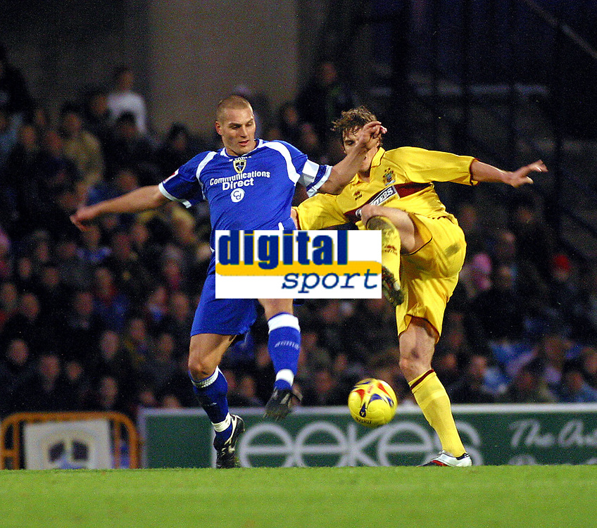 Photo: Dave Linney.<br />Cardiff City v Burnley. Coca Cola Championship. 11/11/2006.Cardiff's  Darren Purse(L) goes in hard on a challenge with  Michael Duff