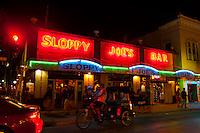Pedicab passing in front of Sloppy Joe's Bar, Duval Street, Key West, Florida Keys, Florida USA