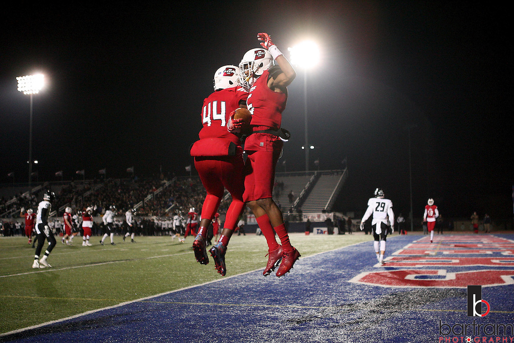 Bishop Dunne's Laquantis Hennington, left, and Ricky Rollerson celebrate Rollerson's touchdown during the TAPPS Division I state championship game on Saturday, Dec. 3, 2016 at Panther Stadium in Hewitt, Texas. Bishop Lynch High School won 21-17. (Photo by Kevin Bartram)