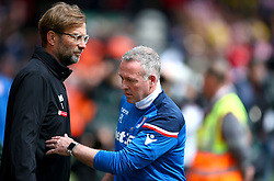 Liverpool manager Jurgen Klopp (left) and Stoke City manager Paul Lambert before the match begins