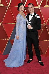 Adam Rippon and Mirai Nagasu walking on the red carpet during the 90th Academy Awards ceremony, presented by the Academy of Motion Picture Arts and Sciences, held at the Dolby Theatre in Hollywood, California on March 4, 2018. (Photo by Sthanlee Mirador/Sipa USA)