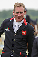 Oliver Townend on the podium having come third in the Equi-Trek CCI competition at Bramham International Horse Trials 2016 at  at Bramham Park, Bramham, United Kingdom on 12 June 2016. Photo by Mark P Doherty.