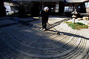 A Zen monk of the Soto School rakes a sand garden as part of meditative practice at the Seiryu-ji Temple in Hikone City, Japan.