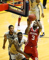 Jan 6, 2018; Morgantown, WV, USA; Oklahoma Sooners forward Khadeem Lattin (3) shoots in the lane during the second half against the West Virginia Mountaineers at WVU Coliseum. Mandatory Credit: Ben Queen-USA TODAY Sports