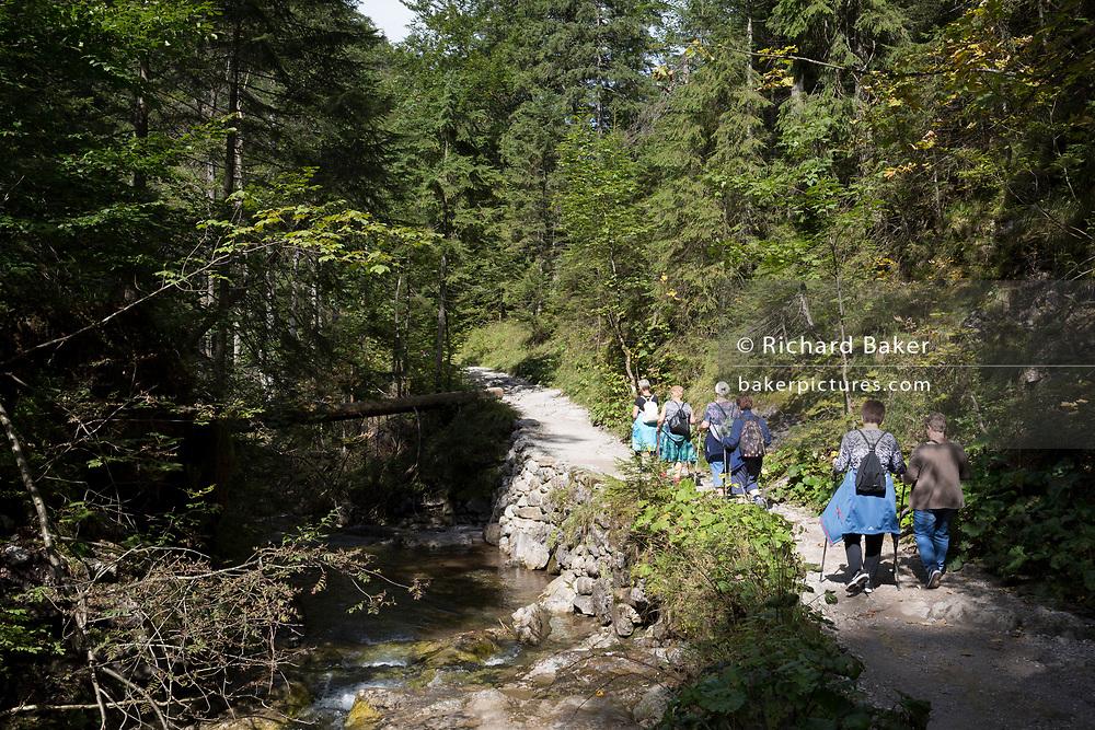 Hikers walk on the footpath near Sarnia Skala, a mountain in the Tatra National Park, on 16th September 2019, near Koscielisko, Zakopane, Malopolska, Poland.