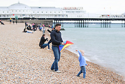 © Licensed to London News Pictures. 05/04/2015. Brighton, UK. People spend the day in Brighton relaxing on the beach on Easter Sunday, Today, April 5th 2015. Photo credit : Hugo Michiels/LNP