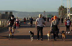 South Africa - Durban -03 MAY 2020 -Coronavirus :  People continued jogging at the beach front  wiht thei families after the promenade was sinitized by Durban Municipality<br /> Picture Bongani Mbatha /African News Agency (ANA)