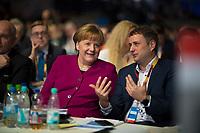 DEU, Deutschland, Germany, Berlin,26.02.2018: Bundeskanzlerin Dr. Angela Merkel (CDU) und Vincent Kokert, Landesvorsitzender der CDU Mecklenburg-Vorpommern, beim Parteitag der CDU in der Station. Die Delegierten stimmten mit großer Mehrheit für die Neuauflage der Großen Koalition (GroKo).