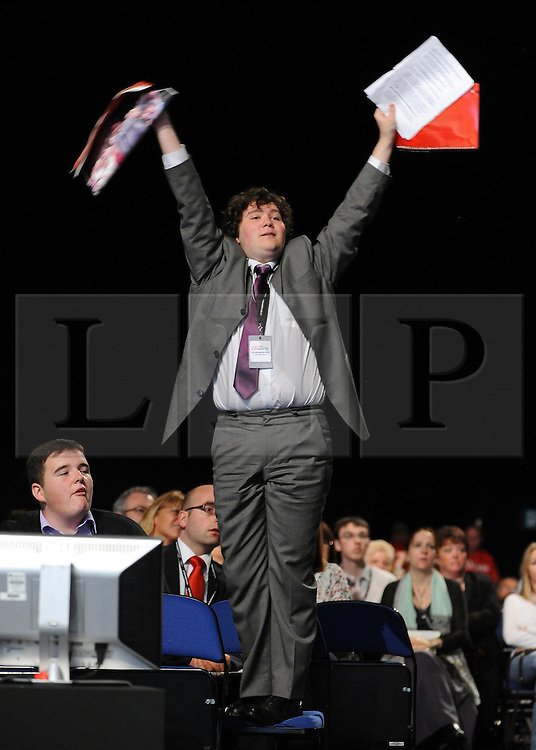© Licensed to London News Pictures. 29/09/2011. LONDON, UK. A delegate waves to the Chair to get attention. The Labour Party Conference in Liverpool today (2829/09/11). Photo credit:  Stephen Simpson/LNP