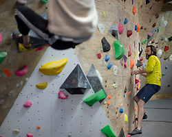 © Licensed to London News Pictures. 12/04/2021. London, UK. Climbers attempt routes at Blocfit climbing gym in Brixton, South London. From today gyms, non essential retail and theme parks can reopen following the easing of lockdown restrictions. Photo credit: George Cracknell Wright/LNP