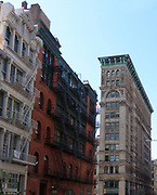 New York City tenement buildings in midtown New York. A mixture of housing and offices, this typical architecture dominated the city to the beginning of the 20th century, when elevators became widespread, enabling skyscapers.