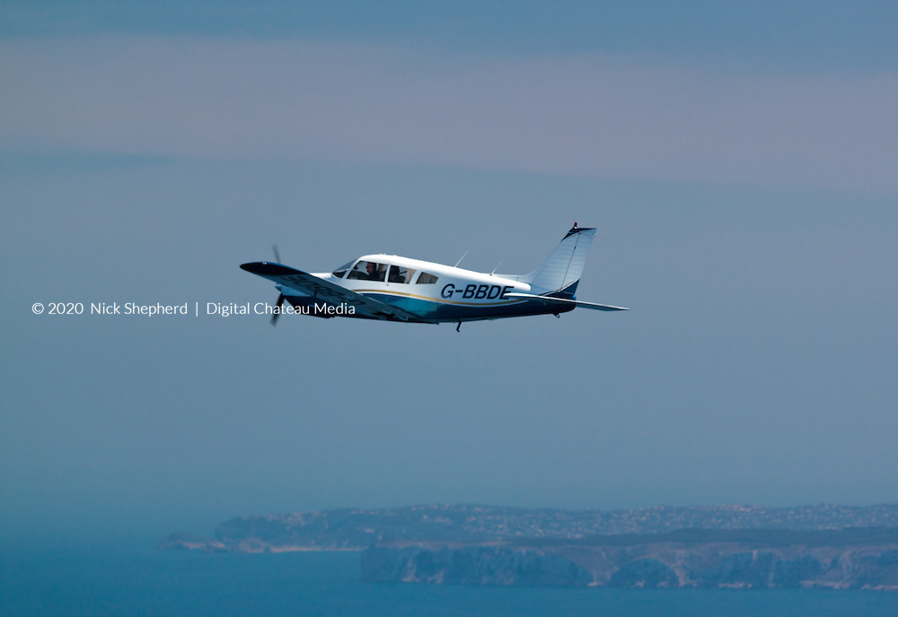 Light aircraft flying along the Spanish coastline over the Mediterranean Sea.