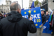Anti Brexit pro European Union protester Steve Bray blocks a pro Brexit protester from filming him in Westminster on 30th October 2019 in London, England, United Kingdom. Brexit is the scheduled withdrawal of the United Kingdom from the European Union. Following a June 2016 referendum, in which 51.9% of participating voters voted to leave. As a General Election is passed through the Commons, Brexit protests intensify outside Parliament the day before the original date of leaving on the 31st.
