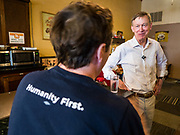 08 JULY 2019 - CRESTON, IOWA: Former Governor JOHN HICKENLOOPER (D-CO) talks to an Iowa voter who asked him about income inequality at a campaign meet and greet in Creston. Hickenlooper is running to be the Democratic nominee in the 2020 Presidential election. At least five staffers left Hickenlooper's campaign last week, including his campaign manager, communications director, digital director and finance director. Hickenlooper named M.E. Smith, who worked on Hickenlooper's successful reelection as Colorado Governor in 2014, as his campaign manager on July 1. Iowa is the first state to hold a presidential selection event in the 2020 election cycle. The Iowa caucuses are February 3, 2020.              PHOTO BY JACK KURTZ