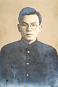 jong adult man in school uniform looking at the camera deteriorating portrait Japan ca 1940s