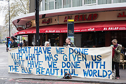 London, UK. 16th April 2019. Extinction Rebellion climate campaigners hold a banner alongside Edgware Road explaining the purpose of the International Rebellion UK activities to call on the Government to take urgent action to address climate change.