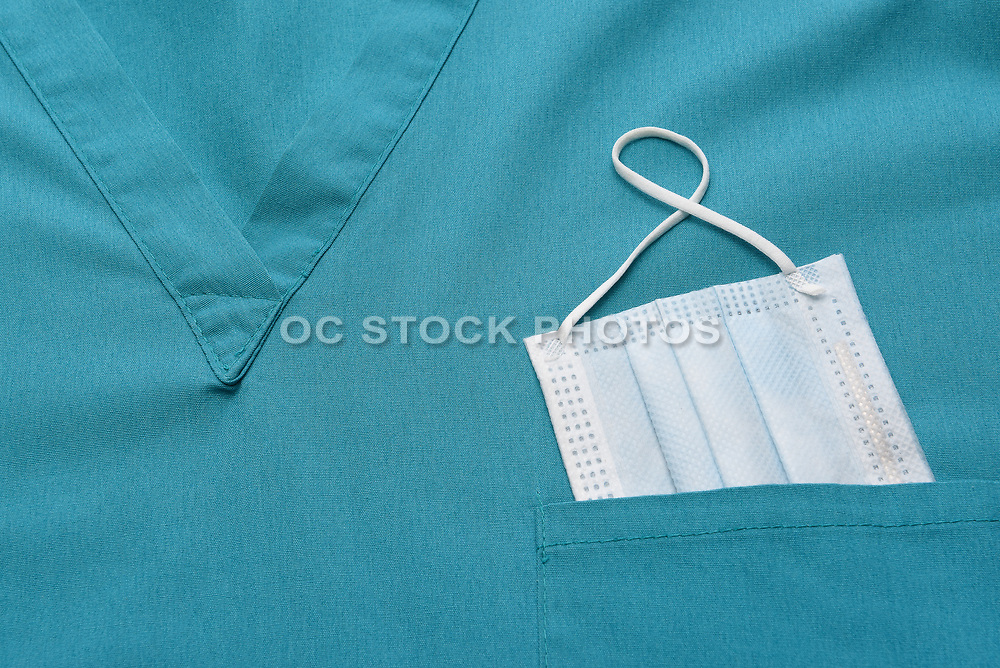Closeup of Medical Scrubs Top With a Surgical Mask in the Pocket