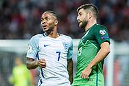 England (7) Raheem Sterling, Slovenia (13)Bojan Jokić during the FIFA World Cup Qualifier match between England and Slovenia at Wembley Stadium, London, England on 5 October 2017. Photo by Sebastian Frej.