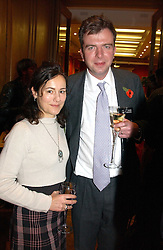 MISS LILY JOHNSTON and MR DAVID KESWICK at an aution of art inspired by footballer David Beckham in aid of The National Deaf Children's Society and held at Christie's, St.James's, London on 4th November 2004.<br />