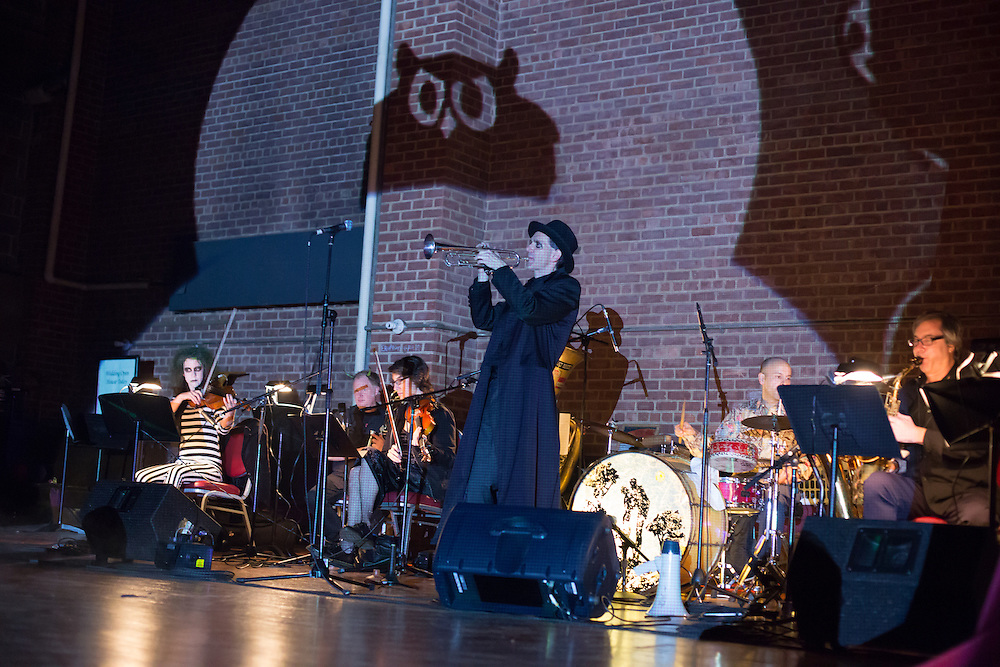 The Ghost Train Orchestra plays swing tunes at the Phantasmagorey Ball, as an owl is projected on the stage wall.