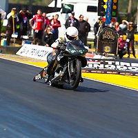 GAINESVILLE, FL - MAR 11, 2011:  Driver, James Surber, brings his Pro Stock Motorcycle down the track during a qualifying run for the Tire Kingdom NHRA Gatornationals race in Gainesville, FL.