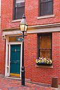 Brick house and gas street lamp on Beacon Hill, Boston, Massachusetts
