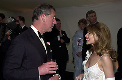 File photo dated 11/6/01 of the Prince of Wales and Kylie Minogue during the 'Its Fashion' charity gala dinner at Waddesdon Manor, Buckinghamshire. The pop star and actress turns 50 on Monday.