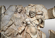 Close up of a Roman Sebasteion relief  sculpture of Aineas' flight from Troy, Aphrodisias Museum, Aphrodisias, Turkey. <br /> <br /> Aineas in armour carries his aged farther Anchises on his shoulders and leads his young son Lulus by his hand. They are fleeing from the sack of Troy. The figure floating behind is Aphrodite, Aineas' mother: she is helping their escape. Old Anchises carries a round box that held images of Troy's ancestral gods. .<br /> <br /> If you prefer to buy from our ALAMY STOCK LIBRARY page at https://www.alamy.com/portfolio/paul-williams-funkystock/greco-roman-sculptures.html . Type -    Aphrodisias     - into LOWER SEARCH WITHIN GALLERY box - Refine search by adding a subject, place, background colour, museum etc.<br /> <br /> Visit our ROMAN WORLD PHOTO COLLECTIONS for more photos to download or buy as wall art prints https://funkystock.photoshelter.com/gallery-collection/The-Romans-Art-Artefacts-Antiquities-Historic-Sites-Pictures-Images/C0000r2uLJJo9_s0