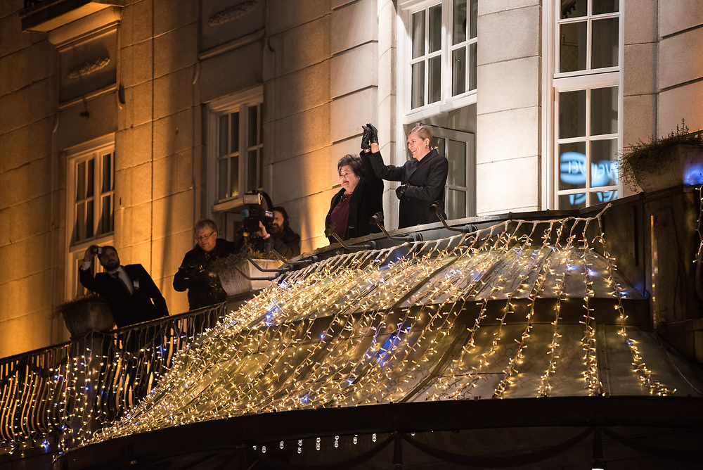 """10 December 2017, Oslo, Norway: In the evening of 10 December some 4,000 people from around the world gathered in central Oslo for a torch light march for peace. The event took place after the Nobel Peace Prize award 2017, awarded to the International Campaign to Abolish Nuclear Weapons (ICAN), for """"its work to draw attention to the catastrophic humanitarian consequences of any use of nuclear weapons and for its ground-breaking efforts to achieve a treaty-based prohibition of such weapons"""". Among the crowd were more than 20 """"Hibakusha"""", survivors of the atomic bombings in Hiroshima and Nagasaki, as well as a range of activists, faith-based organizations and others who work or support work for peace, in one or another way. Here, ICAN representatives Setsuko Thurlow and Beatrice Fihn greeting the crowd by Grand Hotel."""