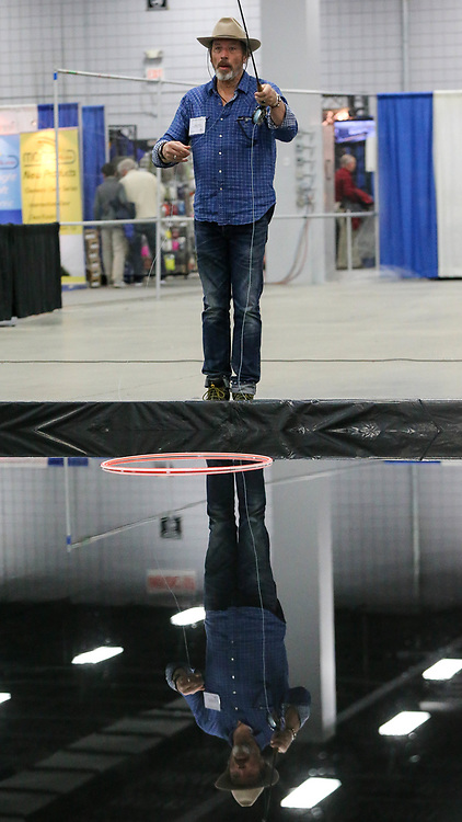 (1/20/18, MARLBOROUGH, MA) Brian Wimmer of Sundance Mountain Resort in Utah, is reflected in the casting pool during the Annual Fly Fishing Show at Best Western Royal Plaza Trade Center in Marlborough on Saturday. [Daily News and Wicked Local Photo/Dan Holmes]
