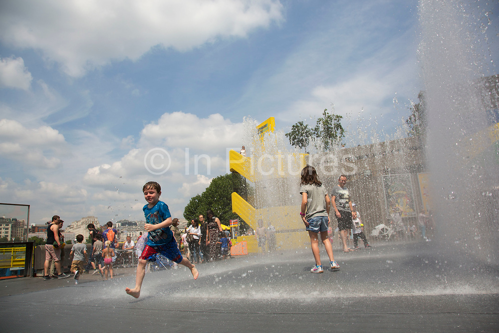 Kids playing in the Appearing Rooms fountains at the Southbank Centre. This Summer water feature / installation is a great draw for families with children, who come to have fun, get wet and lark around in the spray. The South Bank is a significant arts and entertainment district, and home to an endless list of activities for Londoners, visitors and tourists alike.