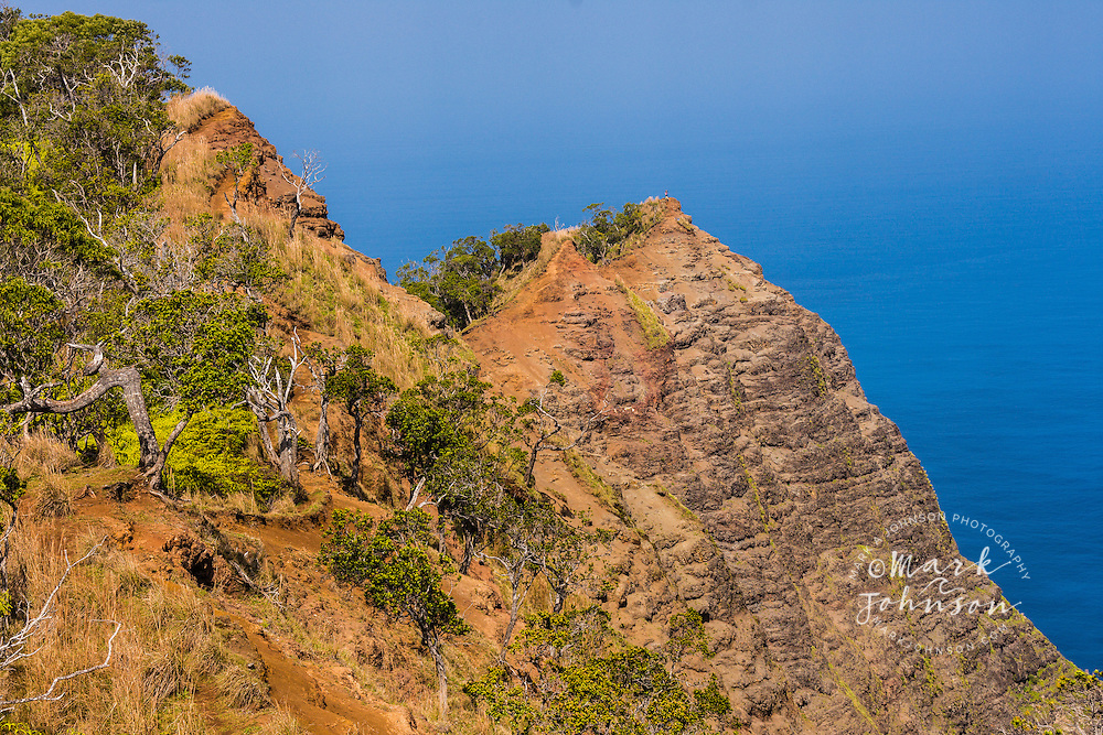 Hikers on a peak above Kalalau Valley on the Na Pali Coast, Kokee, Kauai, Hawaii