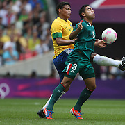 Marco Fabian, Mexico, is challenged by Thiago Silva, Brazil, (left) during the Brazil V Mexico Gold Medal Men's Football match at Wembley Stadium during the London 2012 Olympic games. London, UK. 11th August 2012. Photo Tim Clayton