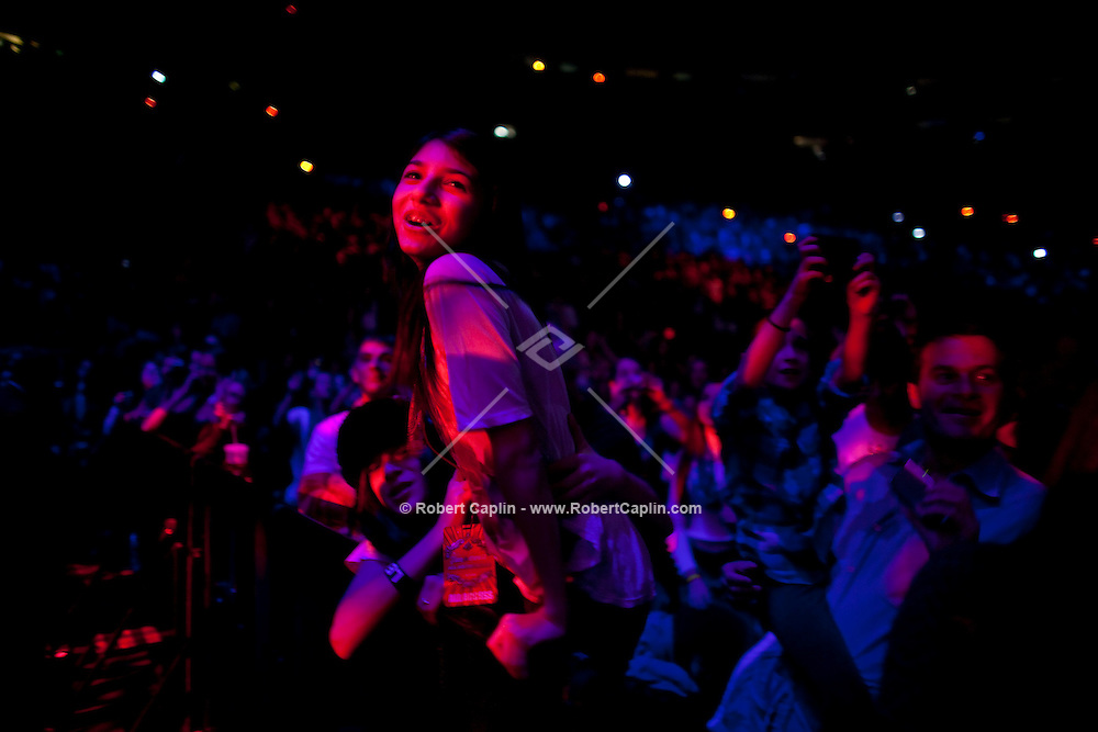 Young fans in the audience scream for Justin Bieber as he performs at the 2009 Z100 Jingle Ball at Madison Square Garden in New York. It was Bieber's first performance at The Garden. ..(Photo by Robert Caplin)...