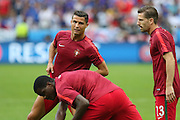 Portugal Forward Cristiano Ronaldo in warm up doing stretches during the Euro 2016 final between Portugal and France at Stade de France, Saint-Denis, Paris, France on 10 July 2016. Photo by Phil Duncan.