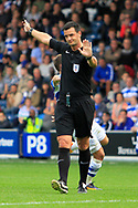 Match referee Andrew Madley declares a foul during the EFL Sky Bet Championship match between Queens Park Rangers and Burton Albion at the Loftus Road Stadium, London, England on 23 September 2017. Photo by Richard Holmes.